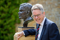 BNPS.co.uk (01202) 558833. <br /> Pic: CorinMesser/BNPS<br /> <br /> Pictured: Turing's nephew and fellow Sherborne School alumni, author Sir John Dermot Turing with the bust. <br /> <br /> A magnificent bronze bust of Enigma codebreaker Alan Turing has today gone on display at his former school.<br /> <br /> The bust, which is just over life size, stands on a plinth at Sherborne School in Dorset, where the genius mathematician and father of computer science was a pupil from 1926 to 1931.<br /> <br /> It was unveiled by Turing's nephew and fellow Sherborne School alumni, author Sir John Dermot Turing.<br /> <br /> During the Second World War Turing worked for the Government Code and Cypher School (GC&CS) at Bletchley Park, Bucks, Britain's code-breaking centre. He played a pivotal role in cracking the German Enigma code that enabled the Allies to defeat the Nazis in many crucial battles.<br /> <br /> The bust has been fashioned by acclaimed sculptor David Williams-Ellis, who has previously commemorated the D-Day landings in sculpture for the Normandy Memorial Trust.