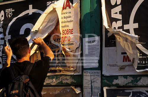 Buenos Aires, Argentina. Young man with political posters, including one with Che Guevara on it.