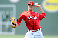 Starting pitcher Trey Ball (32) of the Greenville Drive warms up before his first Class A appearance against the Lexington Legends on Sunday, April 27, 2014, at Fluor Field at the West End in Greenville, South Carolina. Ball was the No. 1 pick of the Boston Red Sox in the 2013 First-Year Player Draft. He is the No. 10 Red Sox prospect, according to Baseball America. Greenville won, 21-6, and Ball got the win. (Tom Priddy/Four Seam Images)