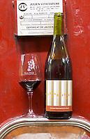 Les Arpettes. Domaine Jean Baptiste Senat. In Trausse. Minervois. Languedoc. Painted steel vats. France. Europe. Bottle. Wine glass.