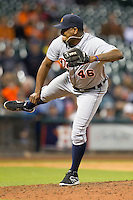 Detroit Tigers pitcher Jose Valverde (46) follows through after he delivers a pitch to the plate during the MLB baseball game against the Houston Astros on May 3, 2013 at Minute Maid Park in Houston, Texas. Detroit defeated Houston 4-3. (Andrew Woolley/Four Seam Images).