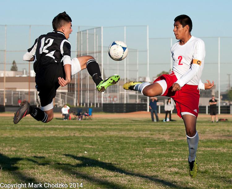 Tustin's Christian Serna and Katella's Armando Silverado get airborne in Wednesday's non-league contest.<br /> <br /> <br /> ///ADDITIONAL INFORMATION: <br /> 12/11/13, MARK CHODZKO, FOR THE REGISTER<br /> Tustin @ Katella Boys Soccer