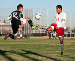 Tustin's Christian Serna and Katella's Armando Silverado get airborne in Wednesday's non-league contest.<br />
