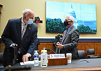 Dr. Anthony Fauci (R), Director, National Institute for Allergy and Infectious Diseases, National Institutes of Health; talks to Dr. Robert Redfield, Director, Centers for Disease Control and Prevention prior to testifying before a House Committee on Energy and Commerce hearing on the Trump Administration's Response to the COVID-19 Pandemic, on Capitol Hill in Washington, DC on Tuesday, June 23, 2020. <br /> Credit: Kevin Dietsch / Pool via CNP/AdMedia
