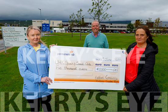 Brendan Griffin, chairman of the Ardfert Community Vintage Tractor Run present a cheque for €5,000 to Mairead  Kelliher and Trease Carroll of the UHK Sports and Social Club at the hospital on Friday.