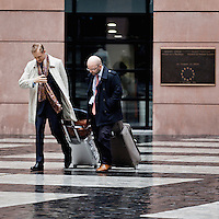 Employees of the European Parliament leaving the building. Every month they, along with thousands of other parliamentary staff, travels between the three sites of government in Brussels, Strasbourg and Luxembourg.