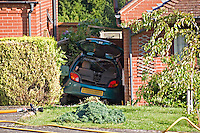 The remains of a Car following the driver driving to fast loosing control and parking it wedged between two houses Warwickshire UK..©shoutpictures.com..john@shoutpictures.com