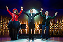 London, UK. 21.03.2014. I CAN'T SING, by Harry Hill and Steve Brown, directed by Sean Foley, opens at the London Palladium. Picture shows: Victoria Elliott (as Jordy), Nigel Harman (as Simon Cowell), and Ashley Wright (as Louis). Photograph © Jane Hobson.
