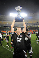 DC United defender Ryan Namoff (26)  holds the Atlantic Cup that was earned after defeating the New York Red Bulls.  DC United defeated the New York Red Bulls 2-0, at RFK Stadium ,Thursday June 4, 2009.