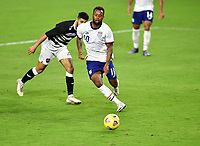 ORLANDO CITY, FL - JANUARY 31: Kellyn Acosta #10 of the United States turns with the ball during a game between Trinidad and Tobago and USMNT at Exploria stadium on January 31, 2021 in Orlando City, Florida.