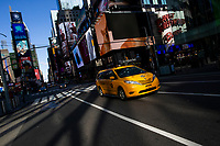 NEW YORK, NY - NOVEMBER 16: A taxi drives through Times Square on November 16, 2020 in New York, NYC bill is looking to put Uber and yellow Cabs on single app platform where riders order from the app any for-hire vehicle, including taxis and cars of Uber or Lyft. (Photo by Eduardo MunozAlvarez/VIEWpress)