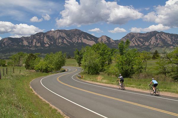 Women cycling on mountain road in Boulder, Colorado .  John leads private photo tours in Boulder and throughout Colorado. Year-round.