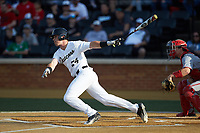 Chris Lanzilli (24) of the Wake Forest Demon Deacons follows through on his swing against the North Carolina State Wolfpack at David F. Couch Ballpark on April 18, 2019 in  Winston-Salem, North Carolina. The Demon Deacons defeated the Wolfpack 7-3. (Brian Westerholt/Four Seam Images)