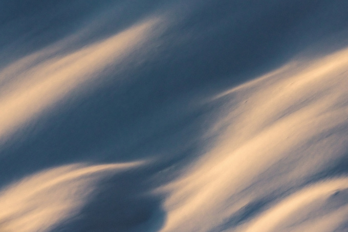 An abstract view of reflected sunset light on fresh snow in Alaska's Chugach Range.