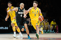 Melbourne, 15 August 2015 - Matthew DELLAVEDOVA of Australia dribbles the ball in game one of the 2015 FIBA Oceania Championships in men's basketball between the Australian Boomers and the New Zealand Tall Blacks at Rod Laver Arena in Melbourne, Australia. Aus def NZ 71-59. (Photo Sydney Low / sydlow.com)