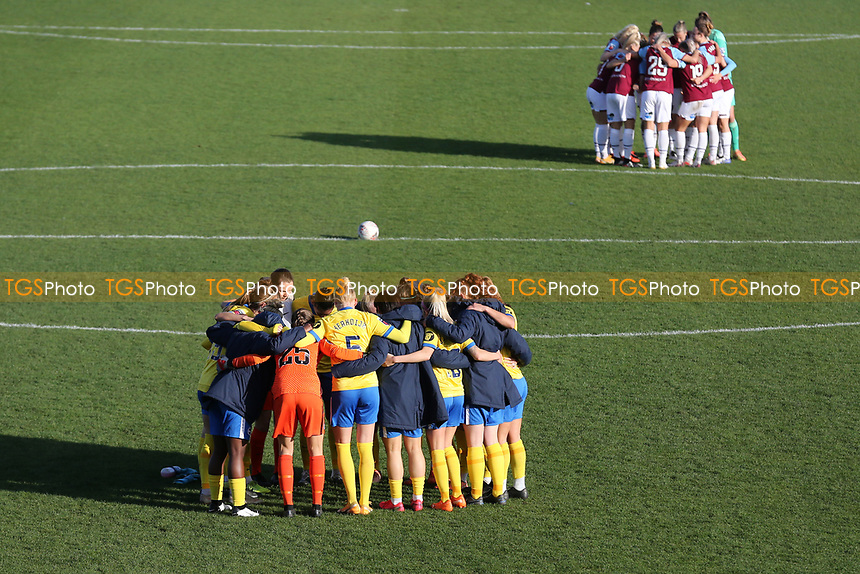 Both teams huddle during West Ham United Women vs Brighton & Hove Albion Women, Barclays FA Women's Super League Football at the Chigwell Construction Stadium on 15th November 2020