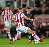 1st October 2021;  Bet365 Stadium, Stoke, Staffordshire, England; EFL Championship football, Stoke City versus West Bromwich Albion; Jordan Hugill of West Bromwich Albion is tacked by James Chester of Stoke City