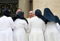 Papa Francesco saluta alcune suore al termine dell'udienza generale del mercoledi' in Piazza San Pietro, Citta' del Vaticano, 10 settembre 2014.<br /> Pope Francis greets some nuns at the end of his weekly general audience in St. Peter's Square at the Vatican, 10 September 2014.<br /> UPDATE IMAGES PRESS/Isabella Bonotto<br /> <br /> STRICTLY ONLY FOR EDITORIAL USE