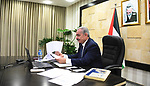Palestinian Prime Minister Mohammad Ishtayeh, chairs the weekly meeting of his government, via a video link in the West Bank city of Ramallah, on March 22, 2021. Photo by Prime Minister Office