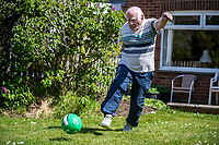 BNPS.co.uk (01202) 558833. <br /> Pic: MaxWillcock/BNPS<br /> <br /> Pictured: Goal-den oldie Dickie Borthwick training in his garden. <br /> <br /> He thinks it's all over - but it's not yet..<br /> <br /> Britain's oldest footballer Dickie Borthwick is vowing to overcome an injury that is threatening to end his 77 year career. <br /> <br /> The 85-year-old, who still plays Sunday league football, has been sidelined by a trapped nerve in his back for three months. <br /> <br /> He is giving himself until August to see if he can recover from the injury and get back playing again but will reluctantly hang up his boots if he can't.