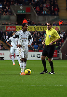 Wednesday, 01 January 2014<br /> Pictured: Jonathan de Guzman of Swansea (L).<br /> Re: Barclay's Premier League, Swansea City FC v Manchester City at the Liberty Stadium, south Wales.