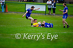 Ballymac's Daire Keane been well marshalled by Jason Hickson and David Smith of Annascaul in Division 2b of the County Football League