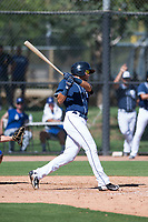 San Diego Padres first baseman Justin Lopez (50) follows through on his swing during an Instructional League game against the Los Angeles Dodgers at Camelback Ranch on September 25, 2018 in Glendale, Arizona. (Zachary Lucy/Four Seam Images)