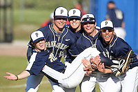 "Pittsburgh Panthers (L-R) Ray Black #15, Kevin Dooley #16, Cole Taylor #22, and Alex Caravella #32 hold up Matt Iannazzo #23 as their ""catch"" before a game vs. the Central Michigan Chippewas at Chain of Lakes Park in Winter Haven, Florida;  March 11, 2011.  Pittsburgh defeated Central Michigan 19-2.  Photo By Mike Janes/Four Seam Images"