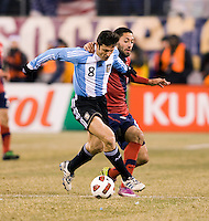Clint Dempsey (8) of the United States fights for the ball with Javier Zanetti (8) of Argentina during an international friendly at New Meadowlands Stadium in East Rutherford, NJ.  The United States tied Argentina, 1-1.