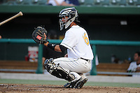 South Bend Silver Hawks catcher Michael Perez (16) warms up the pitcher during a game against the Bowling Green Hot Rods on August 20, 2013 at Stanley Coveleski Stadium in South Bend, Indiana.  Bowling Green defeated South Bend 3-2.  (Mike Janes/Four Seam Images)