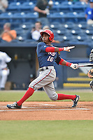 Hagerstown Suns center fielder Victor Robles (16) swings at a pitch during a game against the Asheville Tourists at McCormick Field on April 27, 2016 in Asheville, North Carolina. The Tourists defeated the Suns 14-7. (Tony Farlow/Four Seam Images)
