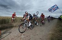 Mathias Frank (SUI/IAM) on the cobbled sector of Artres (1200m)<br /> <br /> stage 4: Seraing (BEL) - Cambrai (FR) <br /> 2015 Tour de France