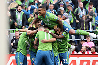 SEATTLE, WA - NOVEMBER 10: Kelvin Leerdam #18 of the Seattle Sounders FC is mobbed by teammates including Kim Kee-hee #20, Joevin Jones #33, and Roman Torres #29 after scoring the game's first goal during a game between Toronto FC and Seattle Sounders FC at CenturyLink Field on November 10, 2019 in Seattle, Washington.