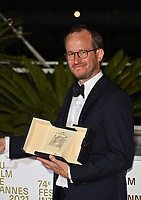 CANNES, FRANCE. July 17, 2021: Juho Kuosmanen at the photocall for Cannes Awards 2021 at the 74th Festival de Cannes.<br /> Picture: Paul Smith / Featureflash