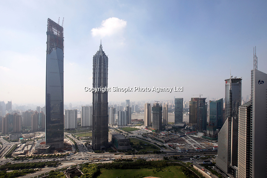 A view of the nearly completed World Financial Center (L) and the Jin Mao Tower (R) in Shanghai, China..10 Sep 2007.