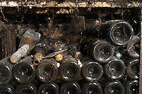 old bottles in the cellar dom coche bizouard meursault cote de beaune burgundy france