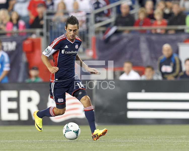 New England Revolution midfielder Diego Fagundez (14) on the attack.  In a Major League Soccer (MLS) match, the New England Revolution (dark blue) defeated Philadelphia Union (light blue), 5-1, at Gillette Stadium on August 25, 2013.
