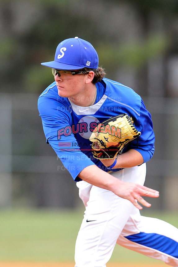 Pitcher Graham Lawson (36) of the Spartanburg Methodist College Pioneers delivers a pitch in a junior college game against Surry Community College on January 31, 2016, at Mooneyham Field in Spartanburg, South Carolina. (Tom Priddy/Four Seam Images)