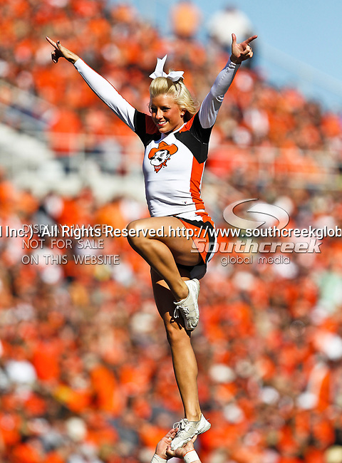 Oklahoma State Cowboys cheerleaders in action during the game between the Baylor Bears and the Oklahoma State Cowboys at the Boone Pickens Stadium in Stillwater, OK. Oklahoma State defeats Baylor 59 to 24.