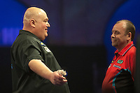 20.12.2014.  London, England.  William Hill World Darts Championship.  Andy Smith (28) [ENG] interacts with the crowd  after winning a leg during his match with Ronny Huybrechts [BEL]. Huybrechts won the match 3-0.