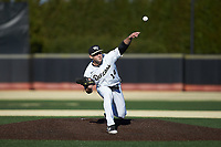 Wake Forest Demon Deacons starting pitcher Jared Shuster (14) delivers a pitch to the plate against the Louisville Cardinals at David F. Couch Ballpark on March 7, 2020 in  Winston-Salem, North Carolina. The Demon Deacons defeated the Cardinals 3-2. (Brian Westerholt/Four Seam Images)