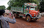 09 August 2013, Hospet, Bellary District, Karnartaka, India : Truck driver  M. Gopal , 20,  in his truck at the road leading to iron mining operations in the Bellary District of Karnartaka India.  Formerly working in illegal mining operations Mr.Gopal and other drivers are now out of work and gather in the hope of finding work at legal mine sites. The illegal mines , operating outside the town of Hospet, have been worked alongside licensed mining operations until they were recently closed down by order of India's Supreme Court. The future of India's economic success is tied up in anti corruption measures and the dislocation of workers who are involved in illegal and corrupt practises has far reaching consequences. Picture by Graham Crouch for the New York Times