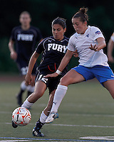 New York Fury substitute forward Gina DiMartino (12) passes the ball under pressure. In a Women's Premier Soccer League Elite (WPSL) match, the Boston Breakers defeated New York Fury, 2-0, at Dilboy Stadium on June 23, 2012.