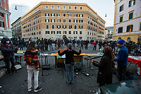 """Menestrella Femminista (Music Band). <br /> <br /> Rome, 03/12/2020. Today, the Nuovo Cinema Palazzo Community held a second public assembly (1.) in Rome's San Lorenzo district to protest against the eviction of the """"Nuovo Cinema Palazzo"""" completed by the Italian police forces in the early morning of the 25th of November and to demonstrate against the violent reaction of the Police forces when, in the evening of the same day, a large demo asked to have the chance to hold a public assembly in the square (Piazza dei Sanniti) of the cinema (2.). The public assembly of today saw the participation and the support & solidarity of the representatives of movements, actors, musicians, students, artists, politicians, and citizens of San Lorenzo who told their stories and memories related to the famous Rome's Art and culture occupation (For example, actor Marcello Fonte, Best Actor Award of the 2018 Cannes Film Festival for the film Dogman, was among the first group of occupiers of the Nuovo Cinema Palazzo). The assembly of the 1st December was interrupted due to the bad weather (3).<br /> The Nuovo Cinema Palazzo was occupied the 15th of April 2011, when citizens, movements, workers of the entertainment industry reopened the former """"Palazzo Cinema"""" to prevent the opening of a casino/gambling space. The illegal occupation was intended as a public hub of art, culture, sport and politics, an open place for exchange, discussion, studies, caring and sharing.<br /> <br /> Footnotes & Links:<br /> 1. http://bit.do/fLCpE<br /> 2. Demo And Clashes Against Nuovo Cinema Palazzo Eviction in Rome's San Lorenzo: http://bit.do/fLxgz<br /> 3. http://bit.do/fLCr3<br /> Previous Stories about Nuovo Cinema Palazzo: 14.04.2018 - Nuovo Cinema Palazzo's Concert: """"7 Anni di CasiNò 