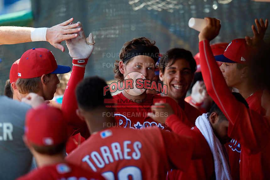 Philadelphia Phillies third baseman Alec Bohm (18) high fives with teammates in the dugout during a Florida Instructional League game against the Toronto Blue Jays on September 24, 2018 at Spectrum Field in Clearwater, Florida.  (Mike Janes/Four Seam Images)