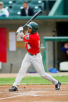 Mallex Smith (3) of the Fort Wayne TinCaps follows through on his swing against the Lansing Lugnuts at Cooley Law School Stadium on June 5, 2013 in Lansing, Michigan.  The TinCaps defeated the Lugnuts 8-5.  (Brian Westerholt/Four Seam Images)
