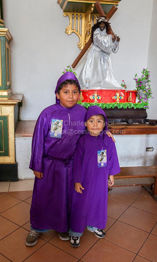 Antigua, Guatemala.  Young Boys Dressed as Novice Cucuruchos, Semana Santa.