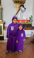 Antigua, Guatemala.  Young Boys Dressed as Novice Cucuruchos, Semana Santa.