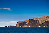 ragged sea cliff and Pu'u Pehe rock aka Sweetheart Rock in distance, Menele Bay, South Lāna'i, Lāna'i aka Pineapple Island because of its past as an island-wide pineapple plantation of Dole, the sixth-largest island of the Hawaiian Islands, Hawaii, USA, Pacific Ocean