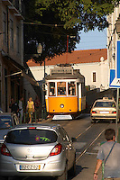 tram and cars alfama district lisbon portugal